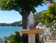 Statua Madonna e spiaggia della Punta